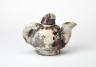 Raku Teapot, Jill Crowley, 1974, Crafts Council Collection: P207.1, P207.2.  Photo: Stokes Photo Ltd.