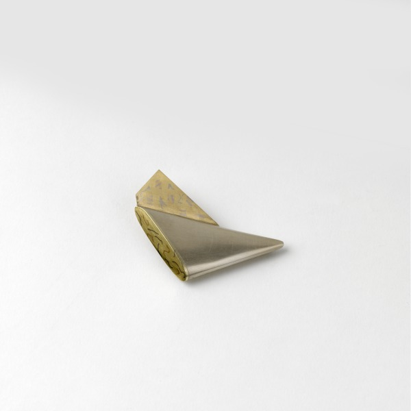 Triangular Winged Brooch With Yellow Gold Wing, 1977-78, Crafts Council Collection: J87. Photo: Todd-White Art Photography.